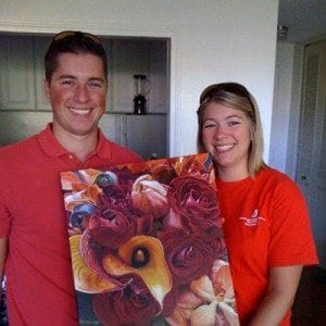 Happy couple with painting