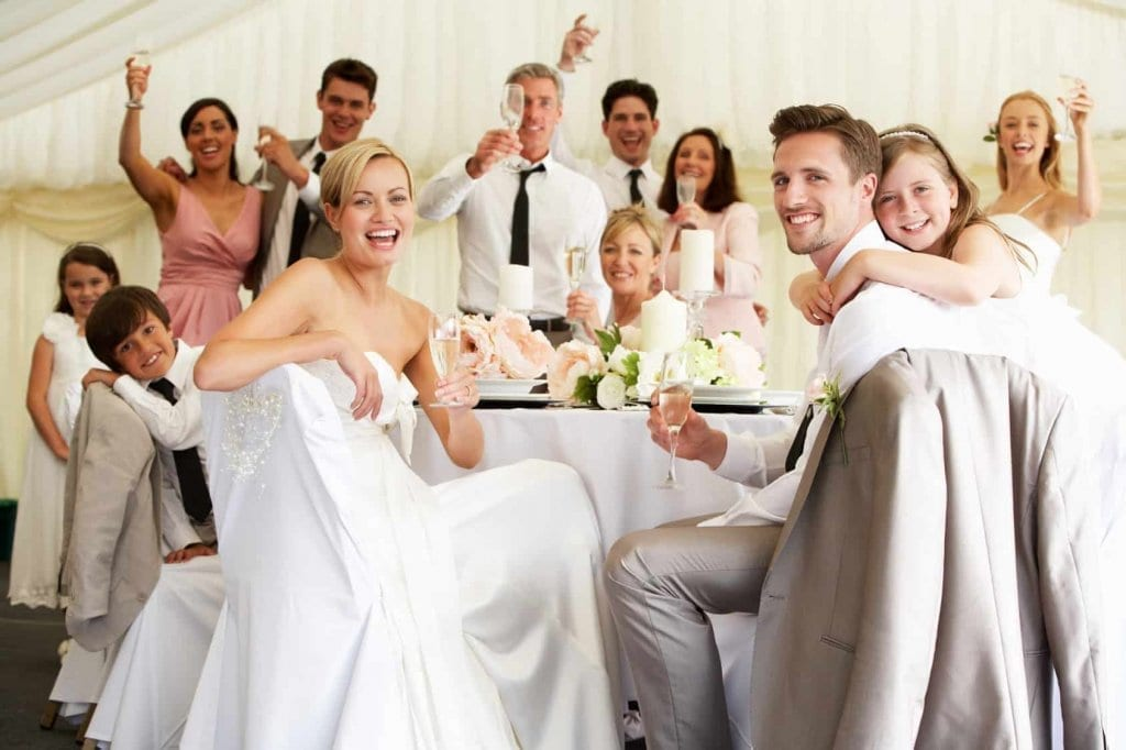 Happy bride and groom with guests