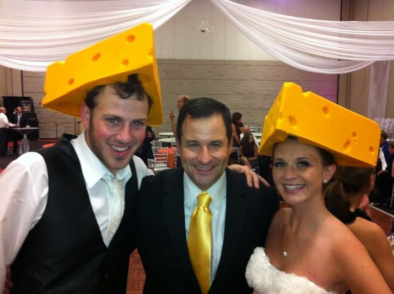 David with couple in cheese hats